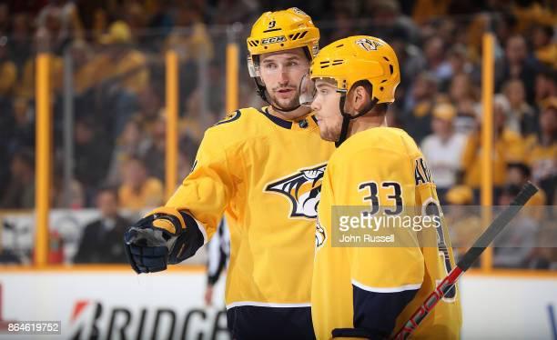 Filip Forsberg and Viktor Arvidsson of the Nashville Predators skate against the Colorado Avalanche during an NHL game at Bridgestone Arena on...