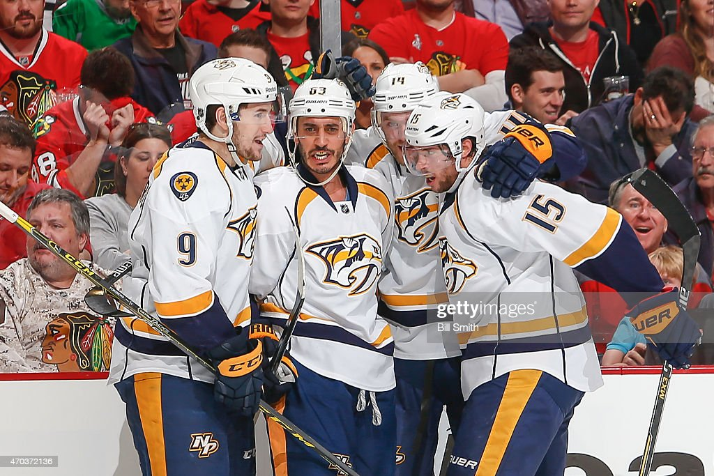 Filip Forsberg #9, Mike Ribeiro #63, Mattias Ekholm #14 and Craig Smith #15 of the Nashville Predators celebrate after Ribeiro scored against the Chicago Blackhawks in the first period during Game Three of the Western Conference Quarterfinals during the 2015 NHL Stanley Cup Playoffs at the United Center on April 19, 2015 in Chicago, Illinois.