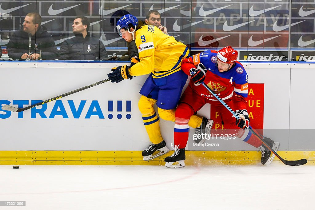 <a gi-track='captionPersonalityLinkClicked' href=/galleries/search?phrase=Filip+Forsberg&family=editorial&specificpeople=8768623 ng-click='$event.stopPropagation()'>Filip Forsberg</a> (L) of Sweden and Nikolai Kulyomin (R) of Russia battle for the puck during the IIHF World Championship quaterfinal match between Sweden and Russia at CEZ Arena on May 14, 2015 in Ostrava, Czech Republic.