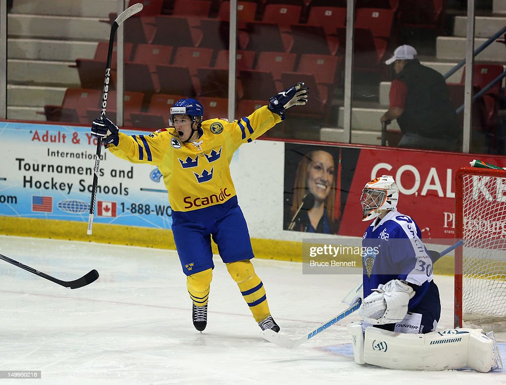 <a gi-track='captionPersonalityLinkClicked' href=/galleries/search?phrase=Filip+Forsberg&family=editorial&specificpeople=8768623 ng-click='$event.stopPropagation()'>Filip Forsberg</a> #16 of Team Sweden celebrates a second period goal by Mika Zibanejad #17 (not shown) against Team Finland at the USA hockey junior evaluation camp at the Lake Placid Olympic Center on August 7, 2012 in Lake Placid, New York.
