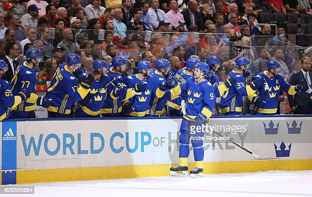 Filip Forsberg of Team Sweden high fives the bench after scoring a first period goal on Team North America during the World Cup of Hockey 2016 at Air...