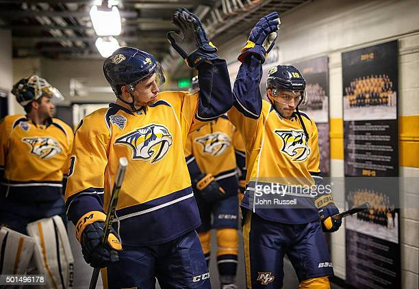 Filip Forsberg of the Nashville Predators and Calle Jarnkrok of the Nashville Predators tap gloves as they walk to the ice for an NHL game against...