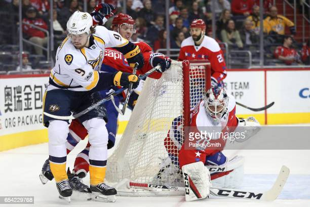 Filip Forsberg of the Nashville Predators and John Carlson of the Washington Capitals battle for the puck during the first period at Verizon Center...