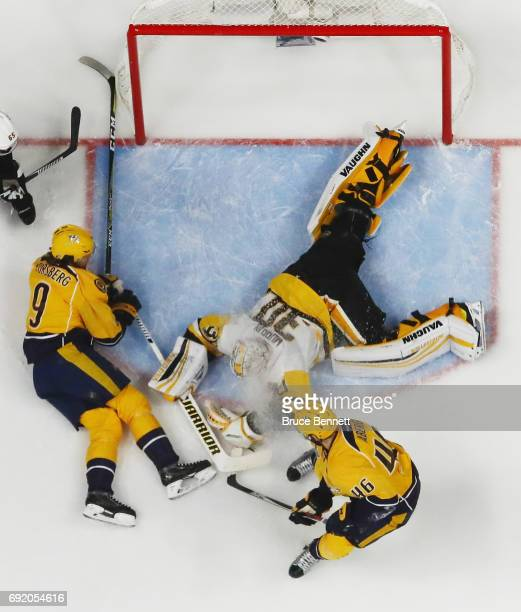 Filip Forsberg of the Nashville Predators and Pontus Aberg of the Nashville Predators converge on Matt Murray of the Pittsburgh Penguins at the...