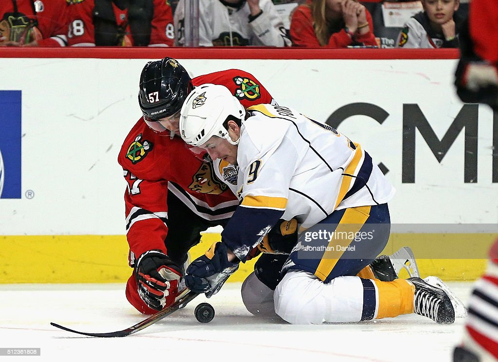 <a gi-track='captionPersonalityLinkClicked' href=/galleries/search?phrase=Filip+Forsberg&family=editorial&specificpeople=8768623 ng-click='$event.stopPropagation()'>Filip Forsberg</a> #9 of the Nashville Predators and <a gi-track='captionPersonalityLinkClicked' href=/galleries/search?phrase=Trevor+van+Riemsdyk&family=editorial&specificpeople=11505180 ng-click='$event.stopPropagation()'>Trevor van Riemsdyk</a> #57 of the Chicago Blackhawks battle for the puck on their knees at the United Center on February 25, 2016 in Chicago, Illinois.