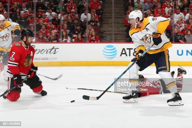 Filip Forsberg of the Nashville Predators approaches the puck in front of Brent Seabrook of the Chicago Blackhawks in the third period at the United...