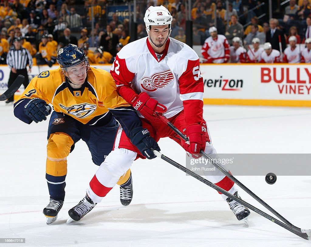 <a gi-track='captionPersonalityLinkClicked' href=/galleries/search?phrase=Filip+Forsberg&family=editorial&specificpeople=8768623 ng-click='$event.stopPropagation()'>Filip Forsberg</a> #9 of the Nashville Predators battle for the puck against <a gi-track='captionPersonalityLinkClicked' href=/galleries/search?phrase=Jonathan+Ericsson&family=editorial&specificpeople=2538498 ng-click='$event.stopPropagation()'>Jonathan Ericsson</a> #52 of the Detroit Red Wings during an NHL game at the Bridgestone Arena on April 14, 2013 in Nashville, Tennessee.