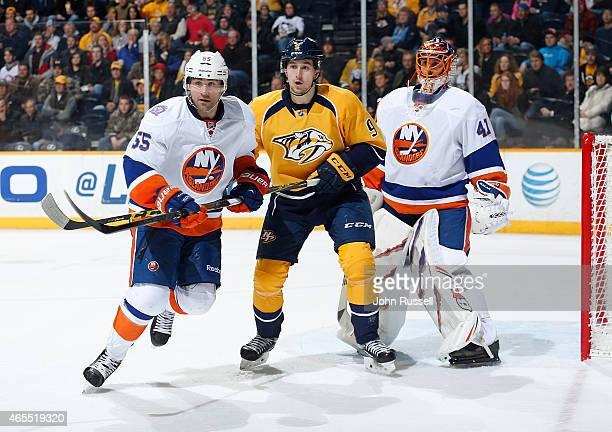 Filip Forsberg of the Nashville Predators battles against Johnny Boychuk and Taylor Beck of the Nashville Predators during an NHL game at Bridgestone...