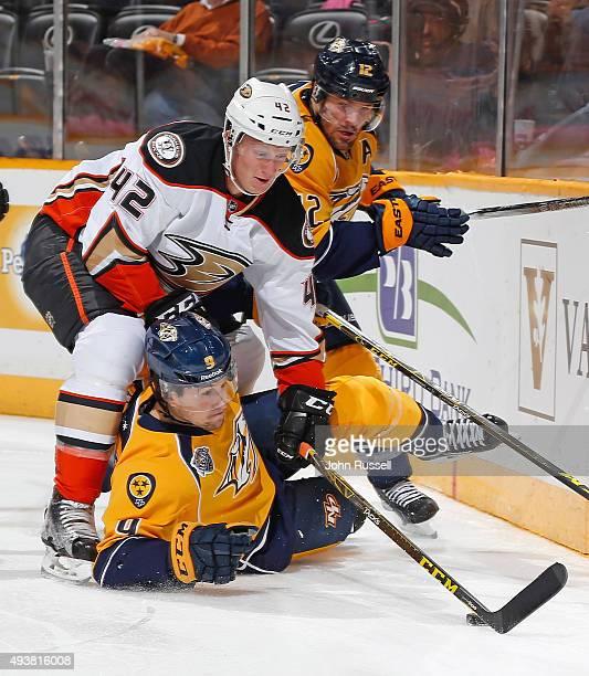 Filip Forsberg of the Nashville Predators battles for the puck against Josh Manson of the Anaheim Ducks during an NHL game at Bridgestone Arena on...