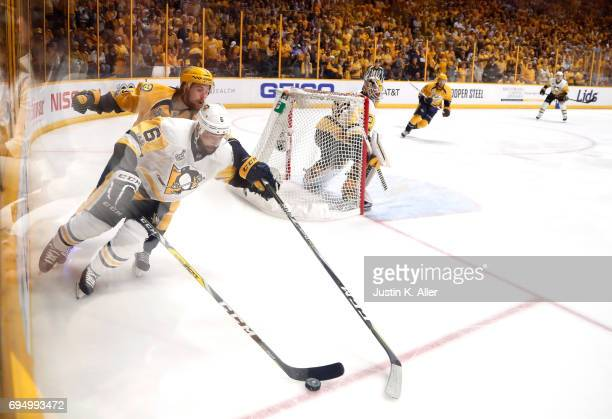 Filip Forsberg of the Nashville Predators battles for the puck with Trevor Daley of the Pittsburgh Penguins during the first period in Game Six of...