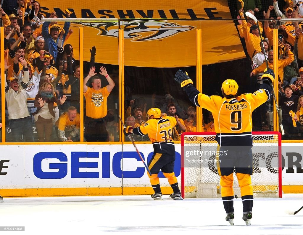 Filip Forsberg #9 of the Nashville Predators celebrates as teammate Viktor Arvidsson #38 scores an open net goal during the final moments of third period in Game Four of the Western Conference First Round against the Chicago Blackhawks during the 2017 NHL Stanley Cup Playoffs at Bridgestone Arena on April 20, 2017 in Nashville, Tennessee.