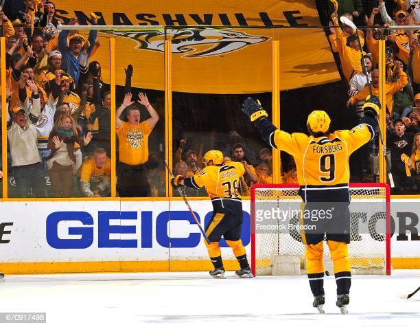 Filip Forsberg of the Nashville Predators celebrates as teammate Viktor Arvidsson scores an open net goal during the final moments of third period in...