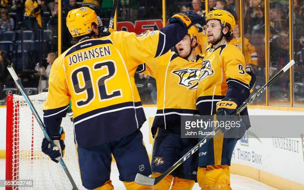 Filip Forsberg of the Nashville Predators celebrates his goal with Viktor Arvidsson and Ryan Johansen against the Winnipeg Jets during an NHL game at...