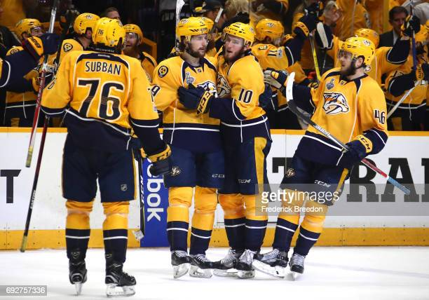 Filip Forsberg of the Nashville Predators celebrates with his teammates after scoring an open net goal against the Pittsburgh Penguins during the...