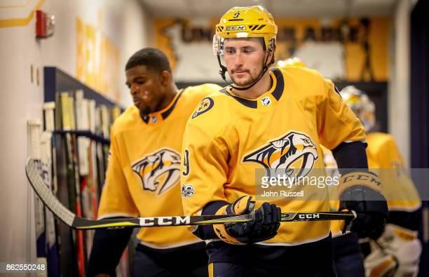 Filip Forsberg of the Nashville Predators checks his stick prior to an NHL game against the Colorado Avalanche at Bridgestone Arena on October 17...