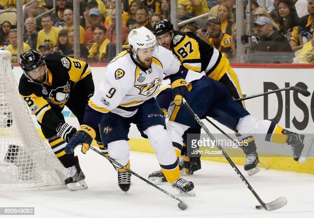 Filip Forsberg of the Nashville Predators controls the puck away from Brian Dumoulin and Sidney Crosby of the Pittsburgh Penguins during the first...