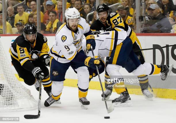 Filip Forsberg of the Nashville Predators controls the puck away from Brian Dumoulin of the Pittsburgh Penguins as Sidney Crosby holds down PK Subban...