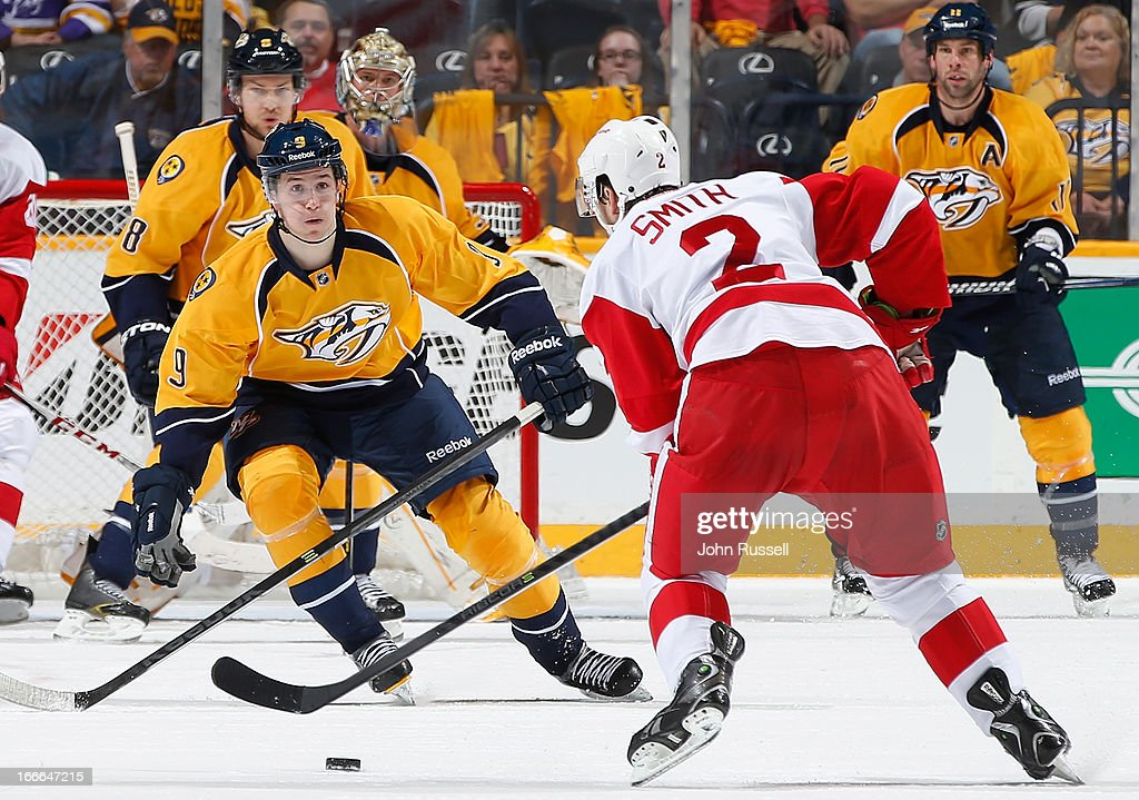 <a gi-track='captionPersonalityLinkClicked' href=/galleries/search?phrase=Filip+Forsberg&family=editorial&specificpeople=8768623 ng-click='$event.stopPropagation()'>Filip Forsberg</a> #9 of the Nashville Predators defends against Brendan Smith #2 of the Detroit Red Wings during an NHL game at the Bridgestone Arena on April 14, 2013 in Nashville, Tennessee.