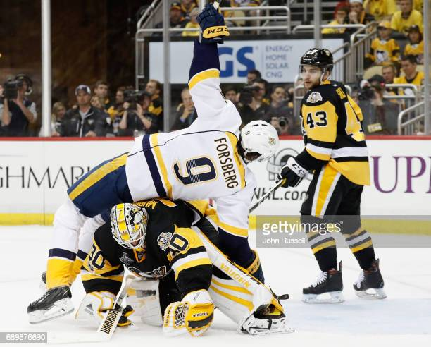 Filip Forsberg of the Nashville Predators fall over goaltender Matt Murray of the Pittsburgh Penguins during the third period of Game One of the 2017...