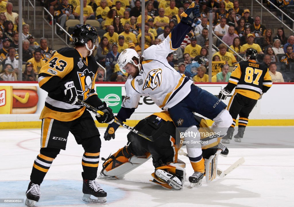 Filip Forsberg #9 of the Nashville Predators falls over goaltender Matt Murray #30 of the Pittsburgh Penguins during the third period of Game One of the 2017 NHL Stanley Cup Final at PPG Paints Arena on May 29, 2017 in Pittsburgh, Pennslyvannia.