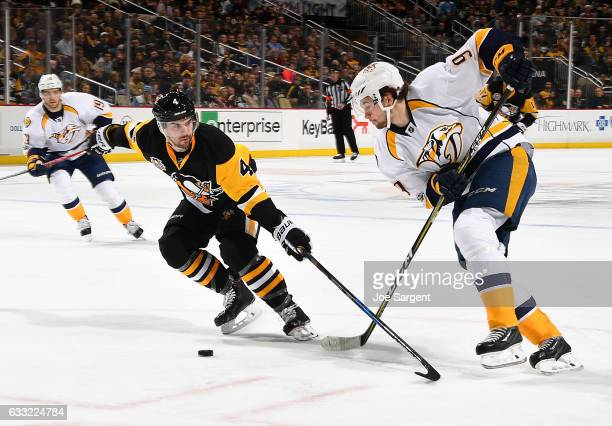 Filip Forsberg of the Nashville Predators handles the puck against Justin Schultz of the Pittsburgh Penguins at PPG Paints Arena on January 31 2017...