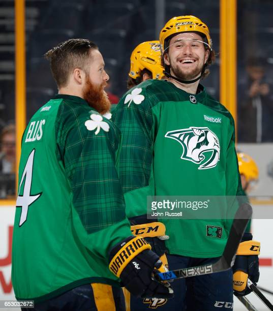 Filip Forsberg of the Nashville Predators has a laugh with Ryan Ellis as they skate in warmups in their green St Patrick's jerseys prior to an NHL...