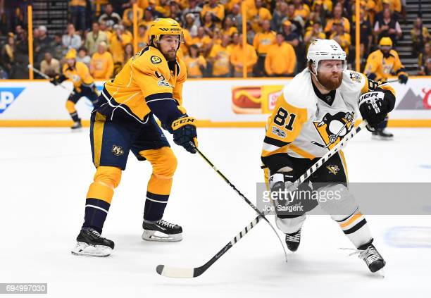 Filip Forsberg of the Nashville Predators hooks the stick of Phil Kessel of the Pittsburgh Penguins in the second period of Game Six of the 2017 NHL...