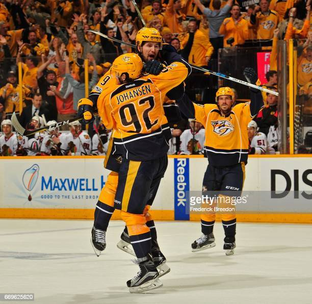 Filip Forsberg of the Nashville Predators jumps into the arms of teammate Ryan Johansen after scoring the gametying goal against the Chicago...