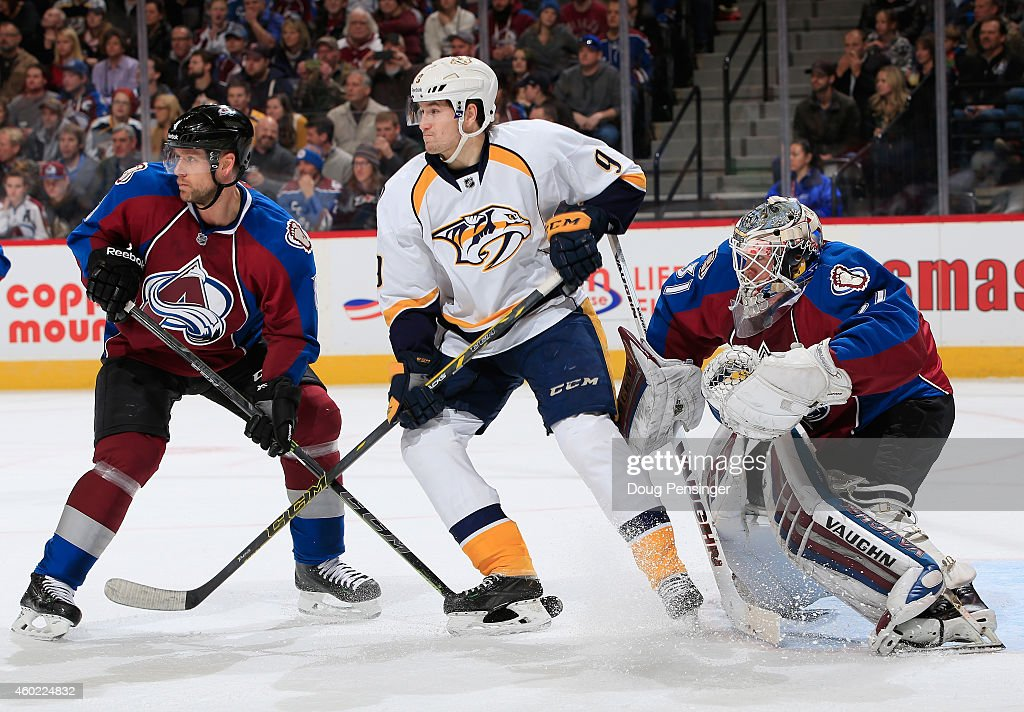 Filip Forsberg #9 of the Nashville Predators looks for the puck against Jan Hejda #8 of the Colorado Avalanche as goalie Calvin Pickard #31 of the Colorado Avalanche defends the goal at Pepsi Center on December 9, 2014 in Denver, Colorado. The Predators defeated the Avalanche 3-0.