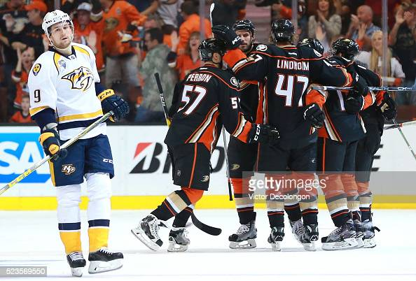 Filip Forsberg of the Nashville Predators looks on dejectedly as David Perron of the Anaheim Ducks celebrates second period goal with teammates Ryan...