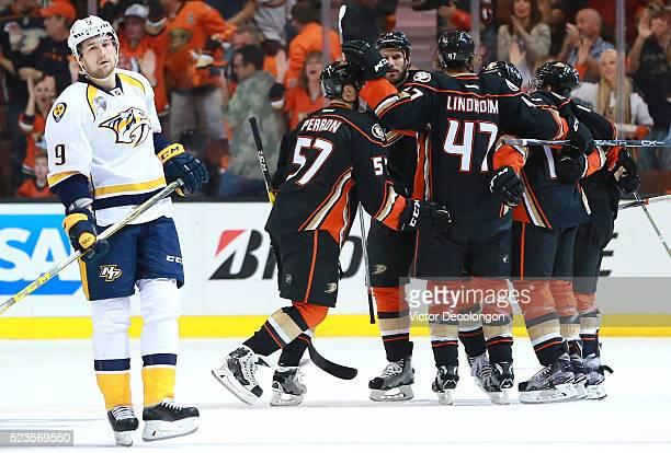 Filip Forsberg of the Nashville Predators looks on dejectedly as David Perron of the Anaheim Ducks celebrates second period goal with teammates Ryan...