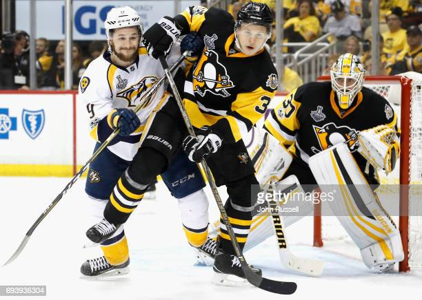 Filip Forsberg of the Nashville Predators Olli Maatta and goaltender Matt Murray of the Pittsburgh Penguins wait for the puck during the third period...