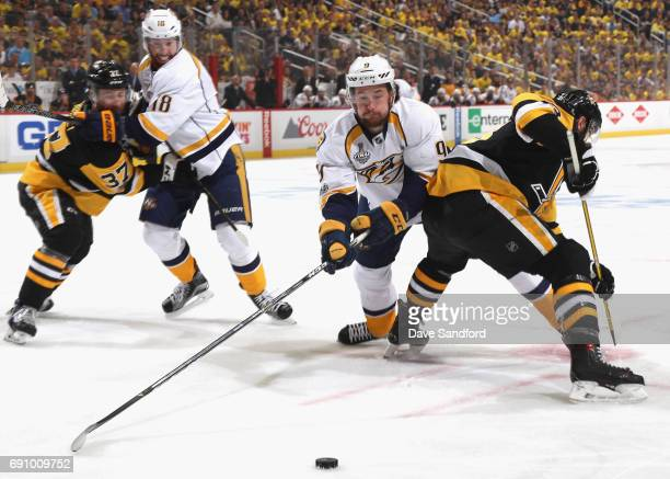 Filip Forsberg of the Nashville Predators reaches for the puck during the first period of Game Two of the 2017 NHL Stanley Cup Final against the...