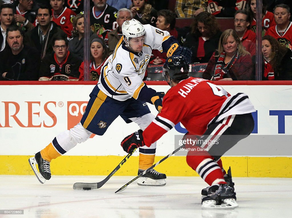 <a gi-track='captionPersonalityLinkClicked' href=/galleries/search?phrase=Filip+Forsberg&family=editorial&specificpeople=8768623 ng-click='$event.stopPropagation()'>Filip Forsberg</a> #9 of the Nashville Predators shoots the puck past <a gi-track='captionPersonalityLinkClicked' href=/galleries/search?phrase=Niklas+Hjalmarsson&family=editorial&specificpeople=2006442 ng-click='$event.stopPropagation()'>Niklas Hjalmarsson</a> #4 of the Chicago Blackhawks at the United Center on January 12, 2016 in Chicago, Illinois.