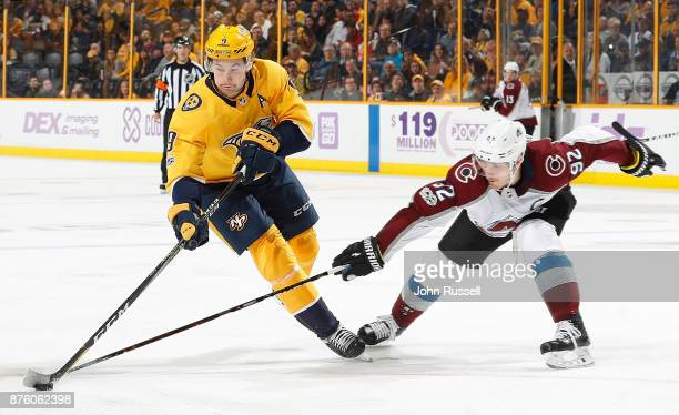 Filip Forsberg of the Nashville Predators skates against Gabriel Landeskog of the Colorado Avalanche during an NHL game at Bridgestone Arena on...