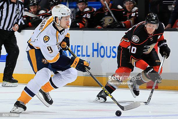 Filip Forsberg of the Nashville Predators skates with the puck against Corey Perry of the Anaheim Ducks in Game Five of the Western Conference First...