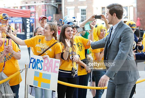 Filip Forsberg of the Nashville Predators slaps hands with his fans as he arrives to play the Carolina Hurricanes on opening night at Bridgestone...