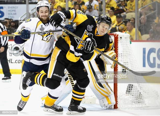 Filip Forsberg of the Nashville Predators tangles with Olli Maatta of the Pittsburgh Penguins in front of the net during the third period of Game...