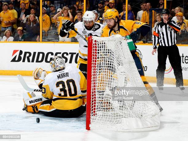 Filip Forsberg of the Nashville Predators watches as the puck rolls past Matt Murray of the Pittsburgh Penguins while Trevor Daley of the Pittsburgh...