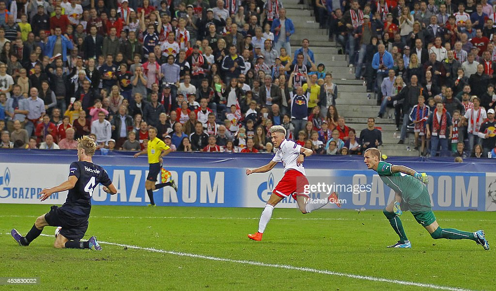 Filip Helander of Malmo FF blocks a shot from Kevin Kampl of FC Salzburg during the UEFA Champions League qualifying play-off at the Red Bull Arena , on August 19, 2014 in Salzburg, Austria.