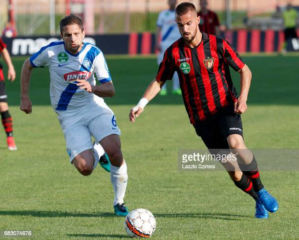 Filip Holender of Budapest Honved competes for the ball with Drazen Okuka of MTK Budapest during the Hungarian OTP Bank Liga match between Budapest...