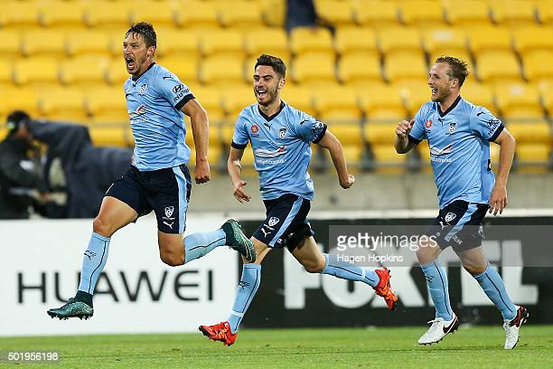 Filip Holosko of Sydney FC celebrates his goal with teammates Chris Naumoff and Rhyan Grant during the round 11 ALeague match between the Wellington...