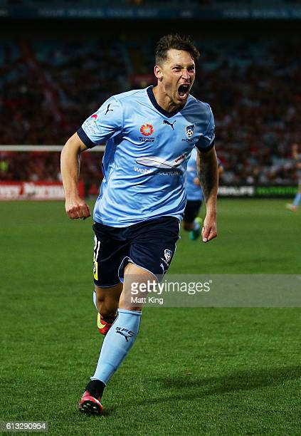 Filip Holosko of Sydney FC celebrates scoring the first goal during the round one ALeague match between the Western Sydney Wanderers and Sydney FC at...