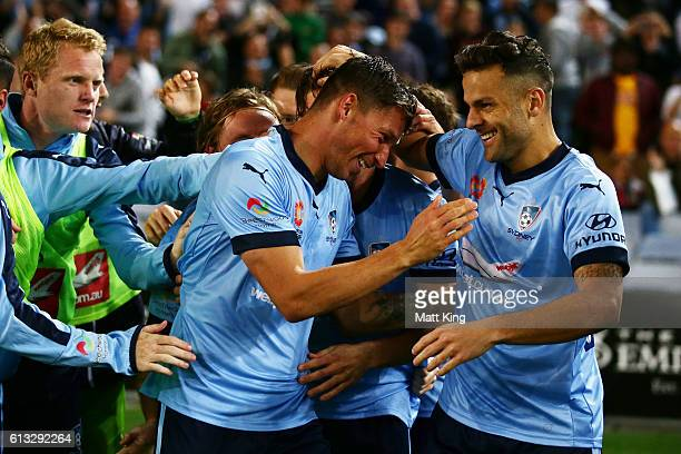 Filip Holosko of Sydney FC celebrates with team mates after scoring the first goal during the round one ALeague match between the Western Sydney...