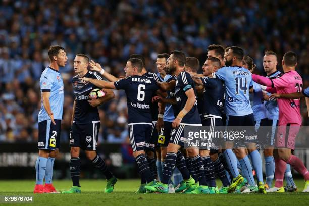 Filip Holosko of Sydney FC faces off against Victory players after a scuffle during the 2017 ALeague Grand Final match between Sydney FC and the...