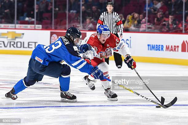Filip Hronek of Team Czech Republic skates the puck against Eeli Tolvanen of Team Finland during the IIHF World Junior Championship preliminary round...