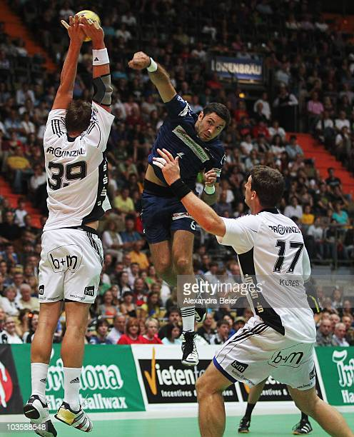 Filip Jicha and Daniel Kubes of THW Kiel challenge Blazenko Lackovic of Hamburg during the Toyota Handball Supercup match between THW Kiel and HSV...