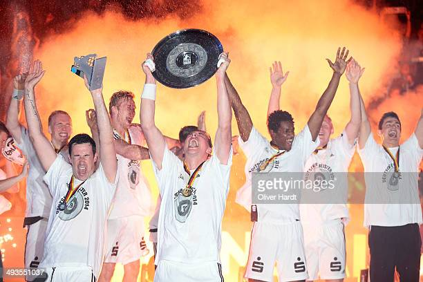 Filip Jicha of Kiel celebrate with the trophy after the DKB HBL Bundesliga match between THW Kiel and Fuechse Berlin on May 24 2014 in Kiel Germany
