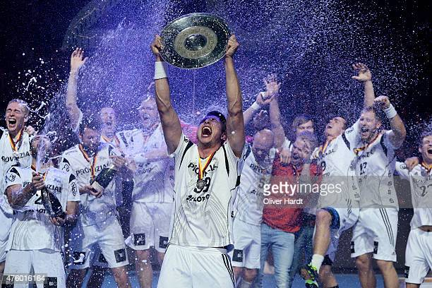 Filip Jicha of Kiel celebrate with the trophy wit his teamates after the DKB HBL Bundesliga match between THW Kiel and TBV Lemgo at Sparkassen Arena...