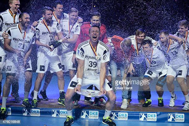 Filip Jicha of Kiel celebrate with the trophy wit his teamates after the DKB HBL Bundesliga match between THW Kiel and TBV Lemgo at Sparkassen Arena...